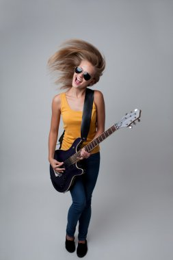 Young woman playing guitar.