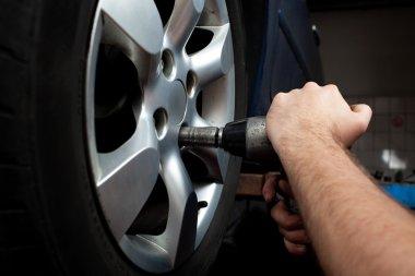 Changing wheel on car