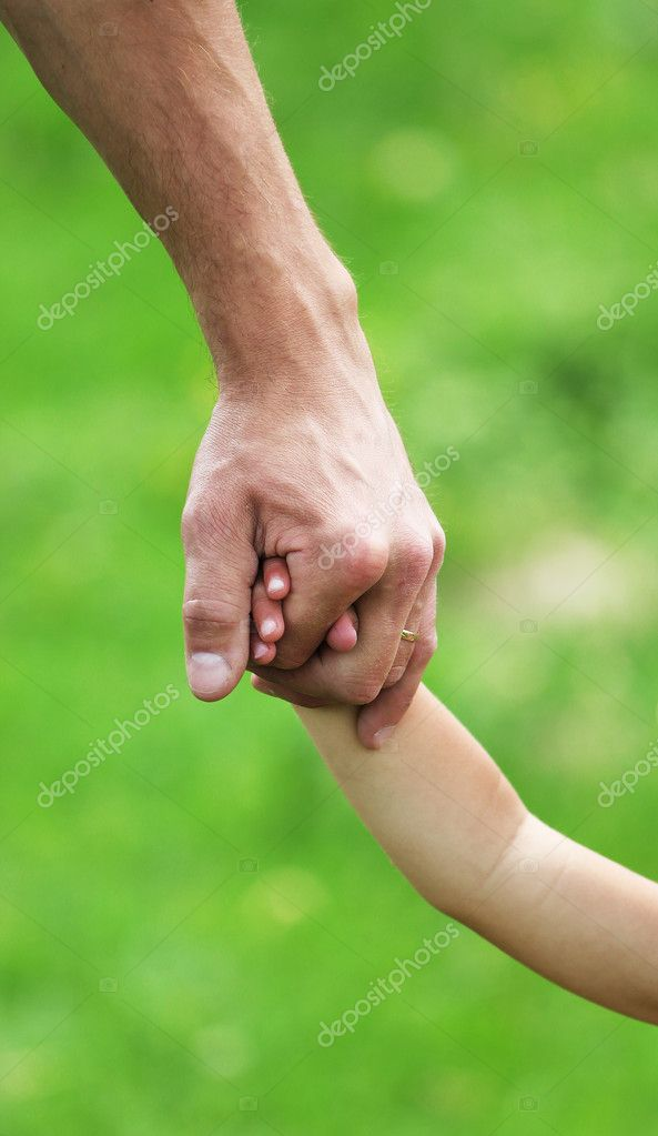 The father and a child holdong hands