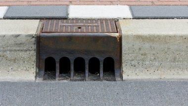 Sidewalk with street drain