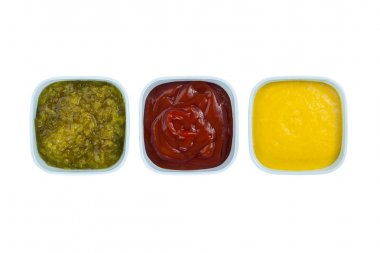 Ketchup mustard pickles on bowl