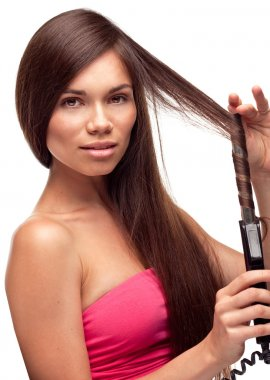 Beautiful pretty girl with long hair doing hairstyle