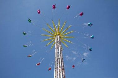 Ferris wheel against a blue sky stock vector