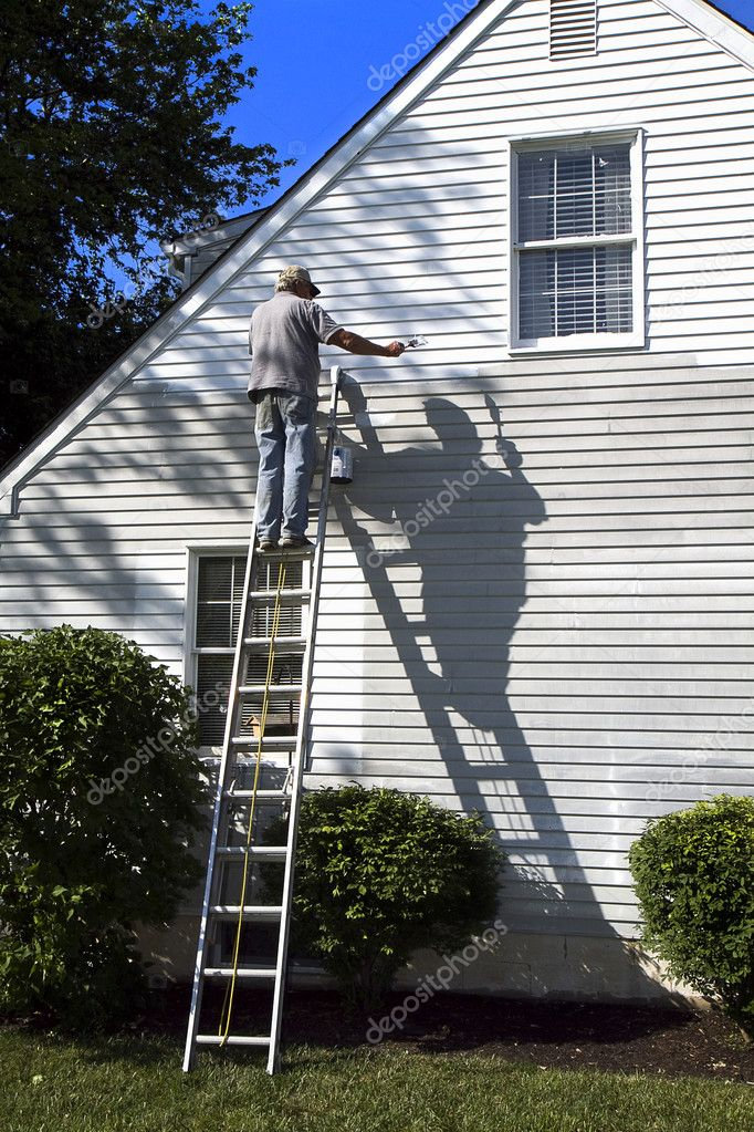 Man & Shadow Painting House — Stock Photo © TrudyWilkerson