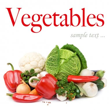 Composition with variety of raw fresh organic vegetables. Isolated over white background