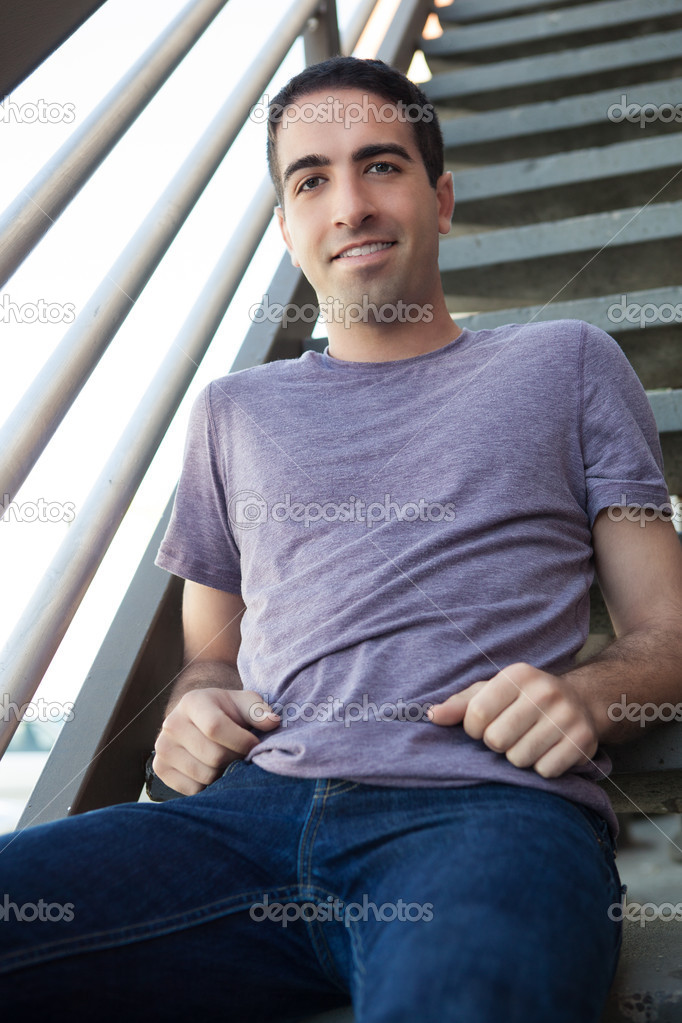 Sexy guy on stairs outdoors