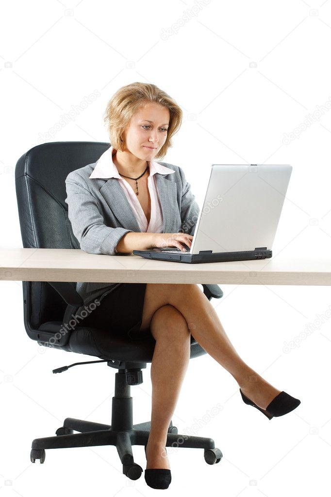 Businesswoman Working Behind Desk Over White Background