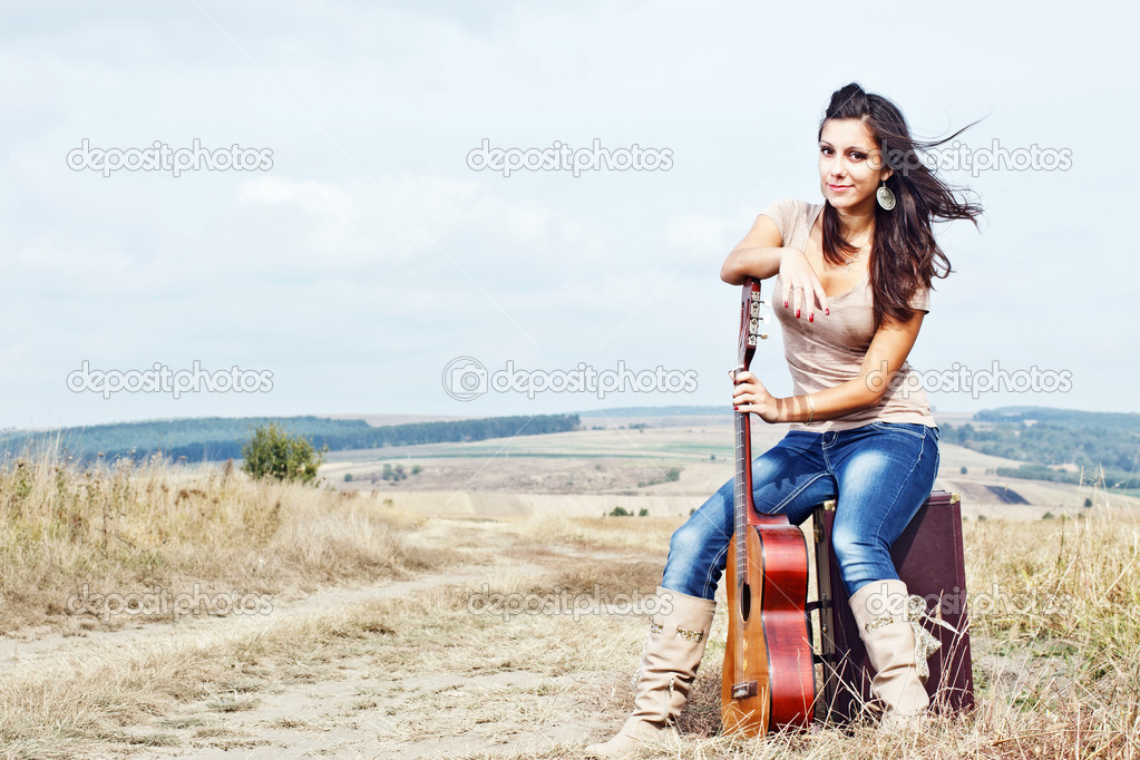 Beautiful sexy country guitar girl