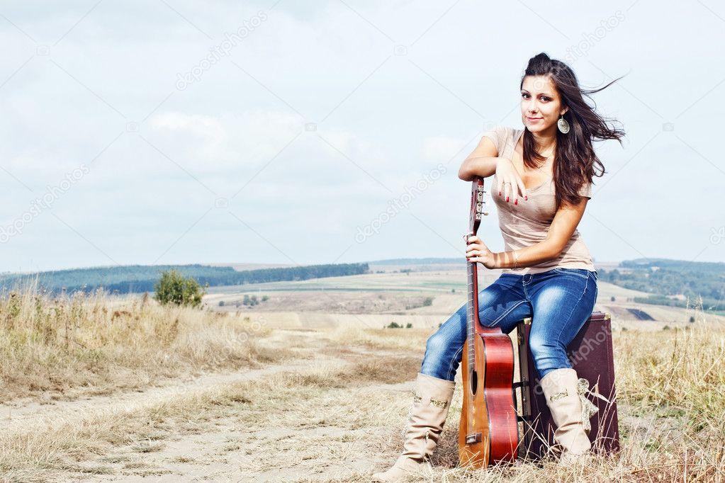 Beautiful sexy country guitar girl