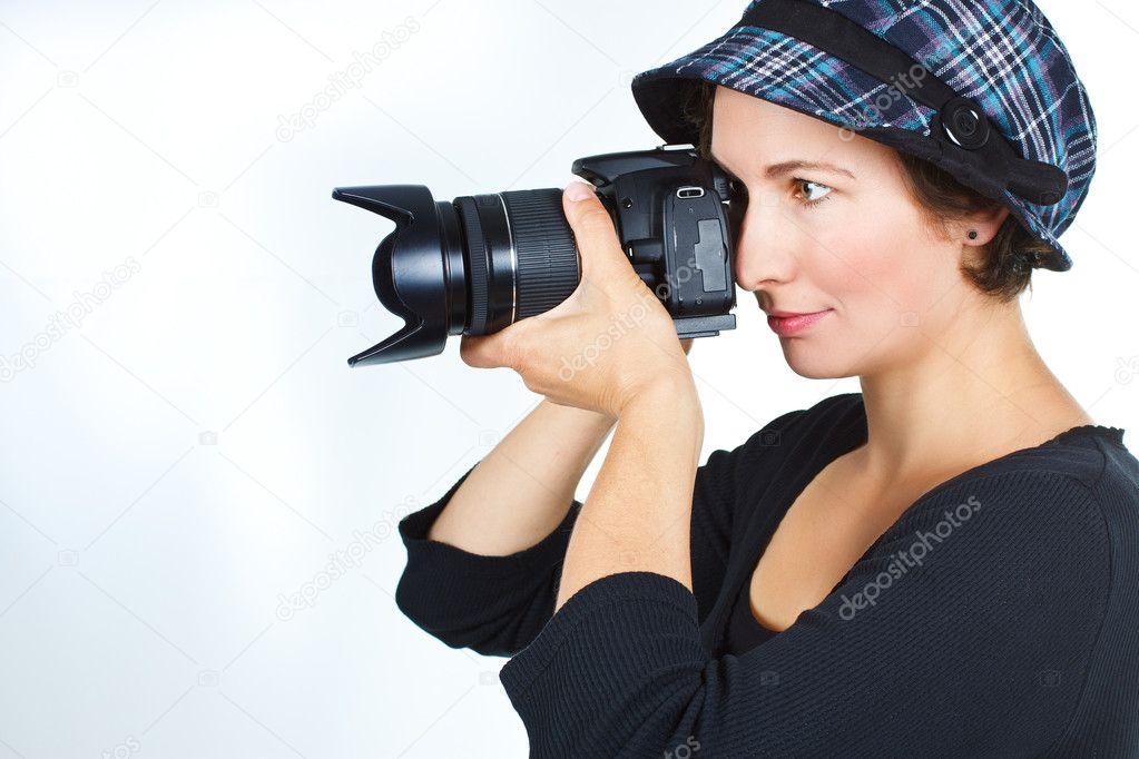 Ritratto di un fotografo di giovane donna con un cappello checked 7e55f4b1cff2
