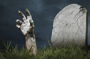 Zombie hand coming out of the ground