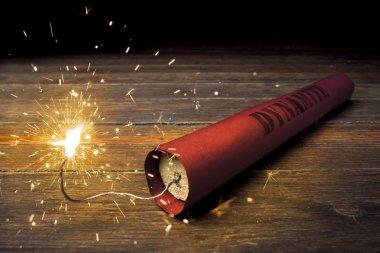 Lit dynamite stick on the floor