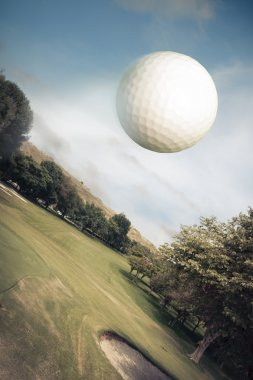 Golf ball flying over the field