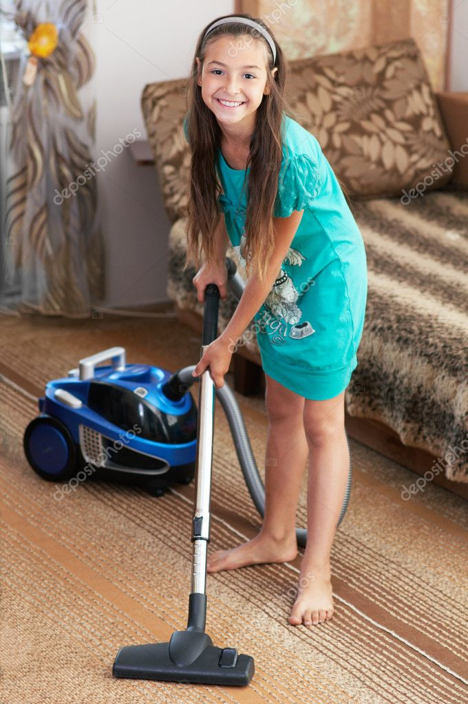 Full Body View Of A Man Drinking Beer At Home While Vacuuming The Carpet Stock