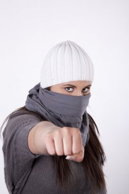 Young masked woman with closed fist