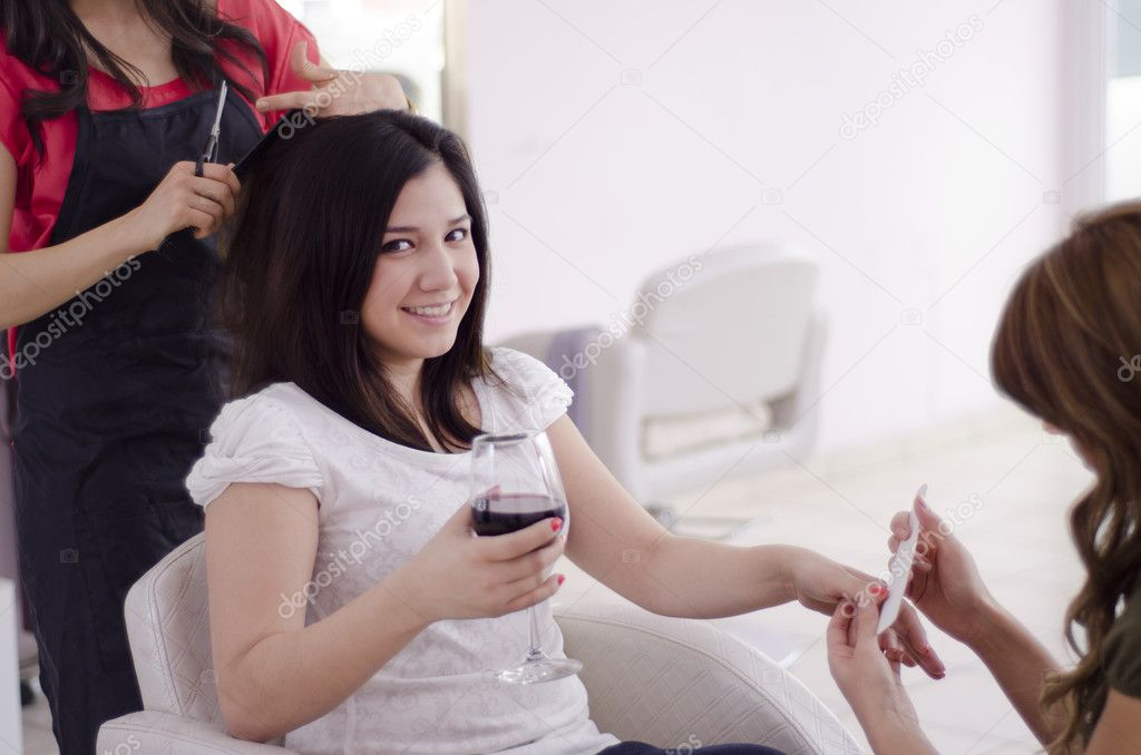 Cute female being pampered at a beauty salon