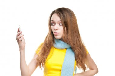 Surprised girl holding phone in her hand.