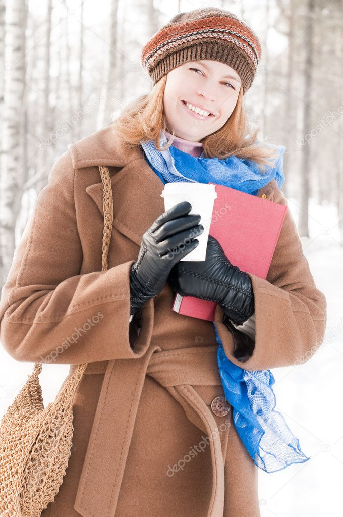 Young woman with books in winter