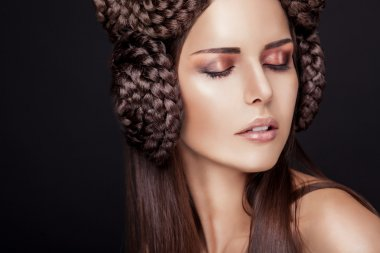Beautiful fashion model with a creative hairstyling