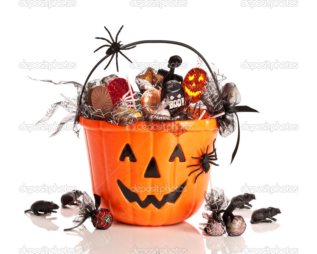 Trick or treat halloween bucket filled with candies and spiders on white background