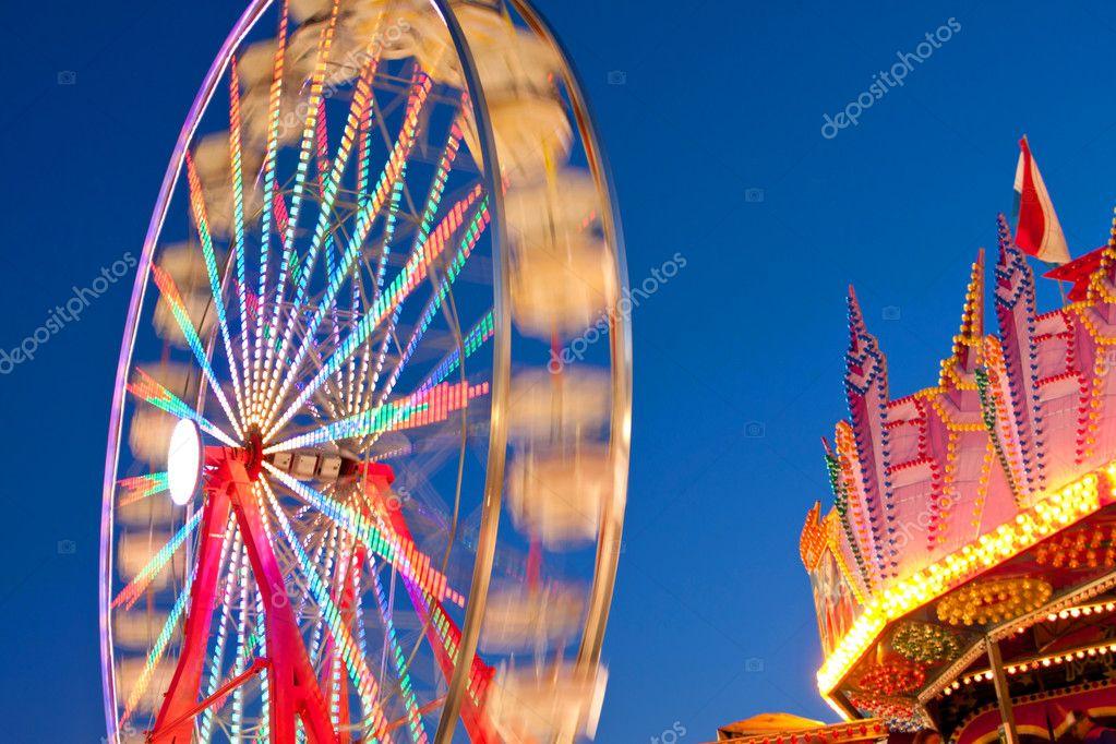 Ferris Wheel Motion Blurs At Dusk