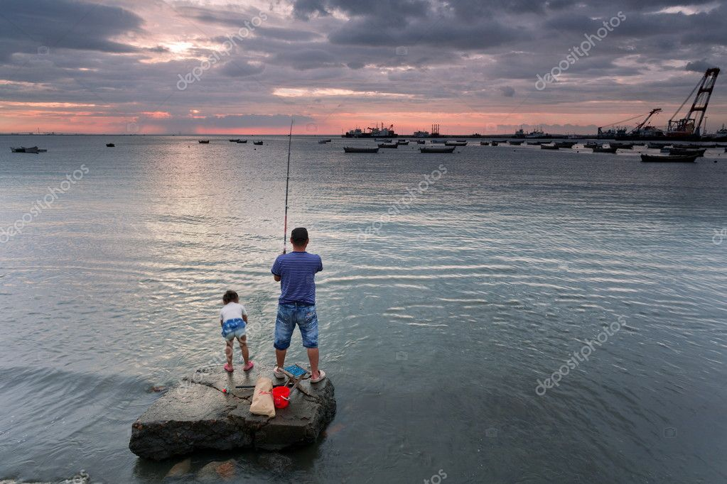 Fishing father and daughter