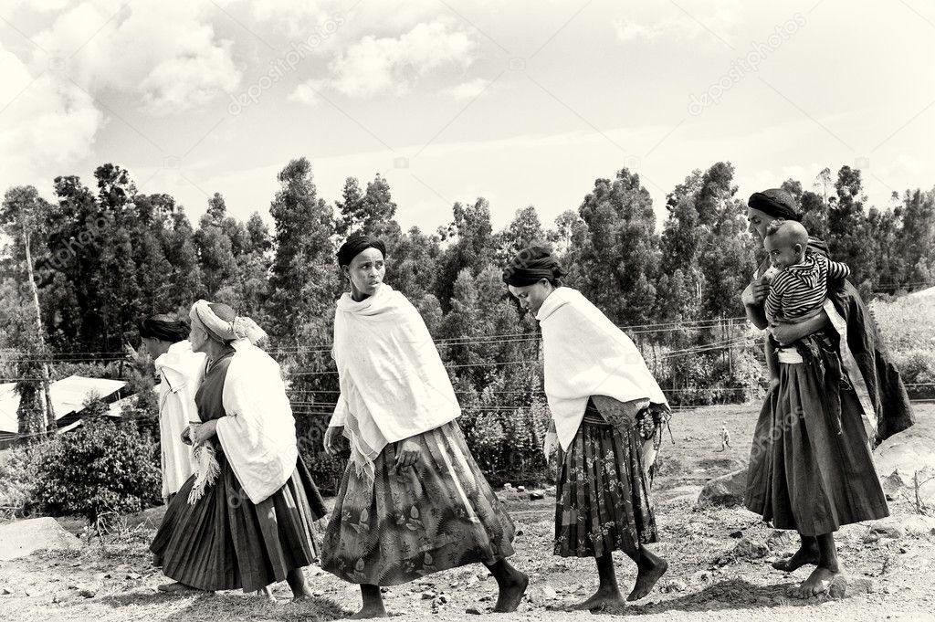 Group of Ethiopian women crosses the field