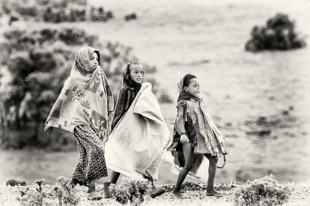 Three Ethiopian girls walk around
