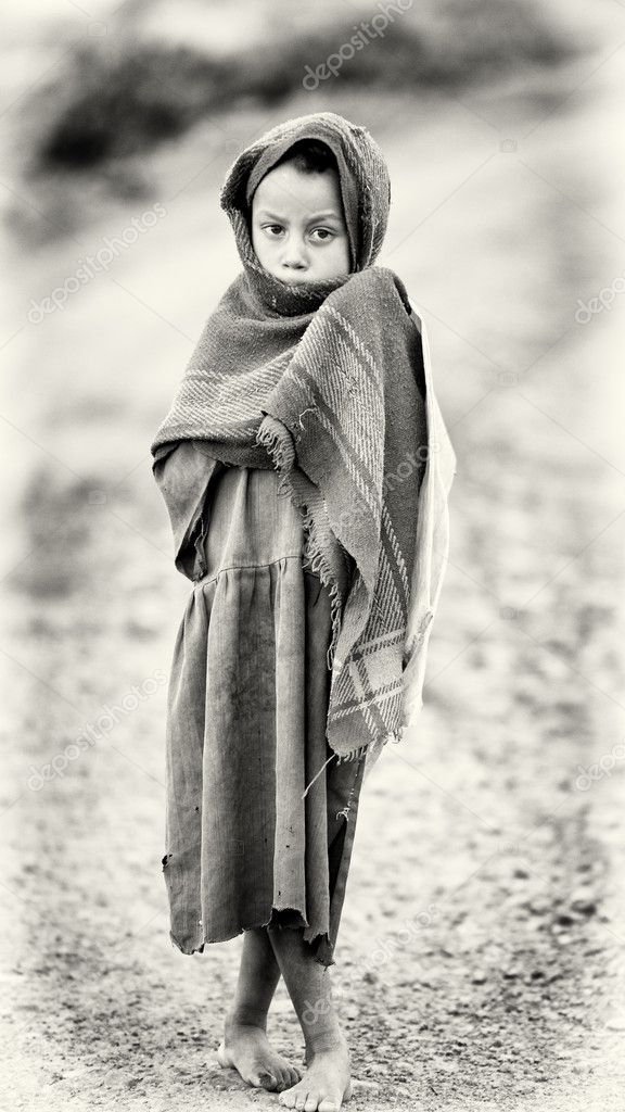 An Ethiopian boy wears the old blanket and poses for the camera