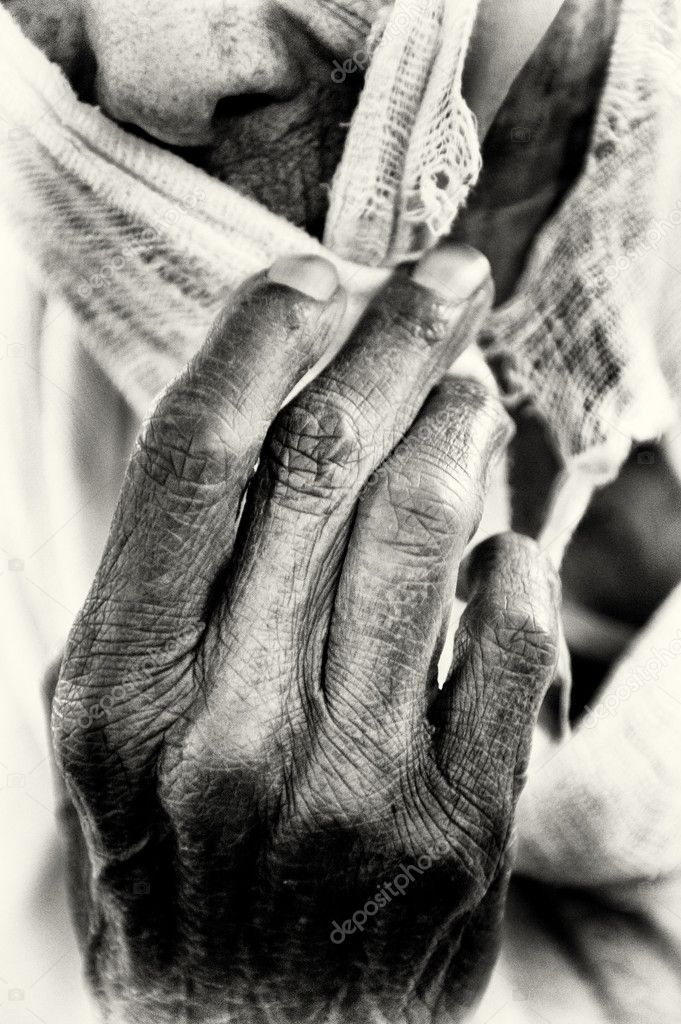 An Ethiopian woman covers her face with her hand