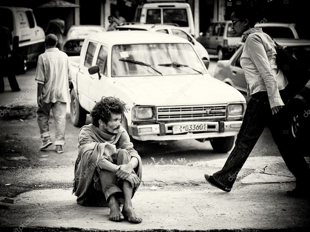 An Ethiopian homeless man sits on the road