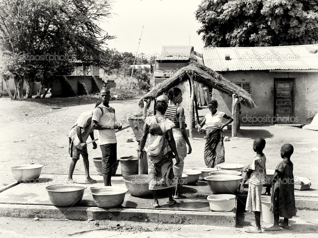 A group of Benin near the well waiting for the turn to get the water