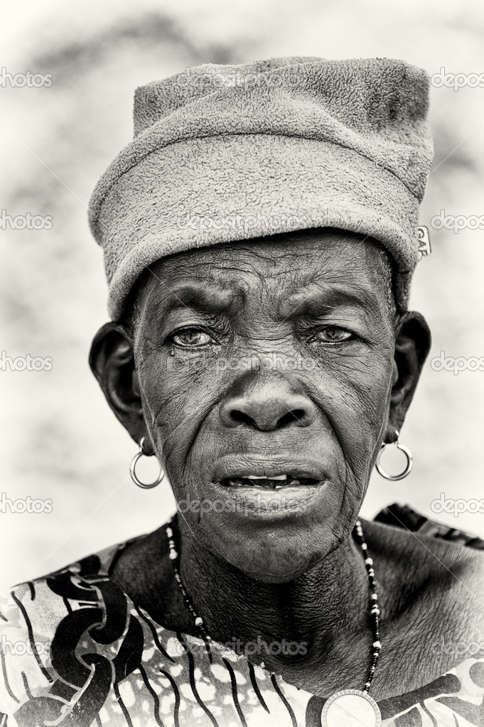 A Benin old lady watches attentively