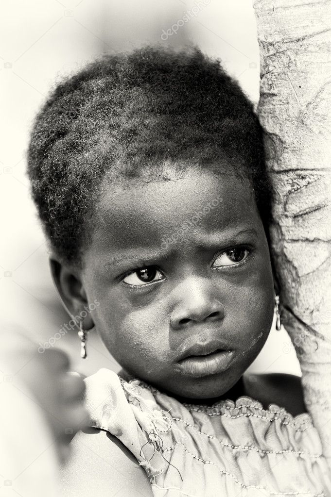 A Benin little girl watches attentively