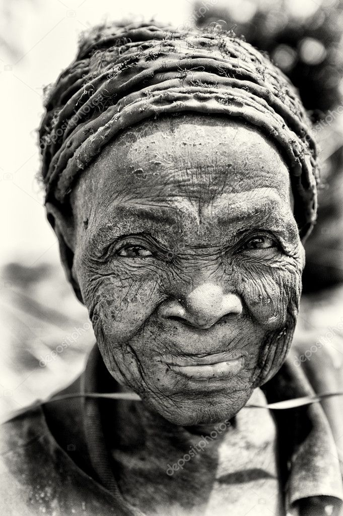 An old woman smiles