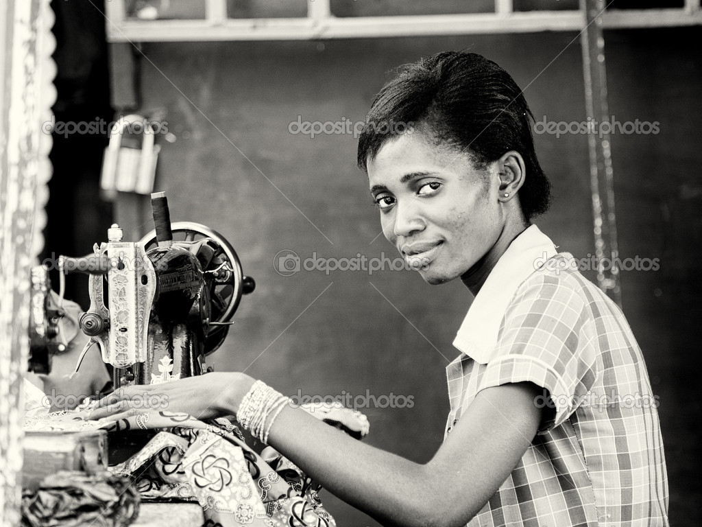 A Ghanaian woman sews using the sewing machine