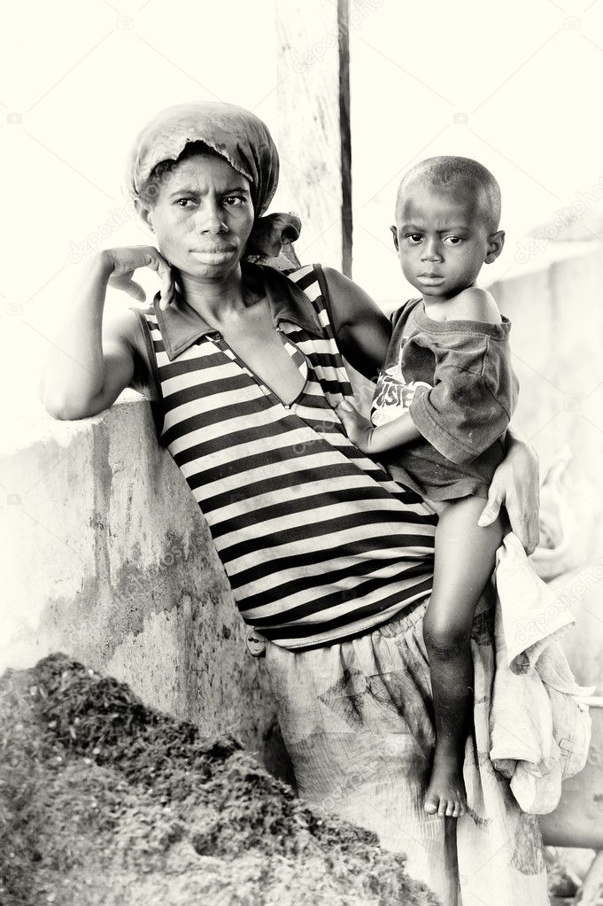 Little Ghanaian baby on the arms of his mother