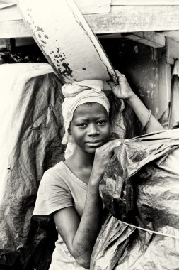 Beautiful Ghanaian woman with a basin over the head
