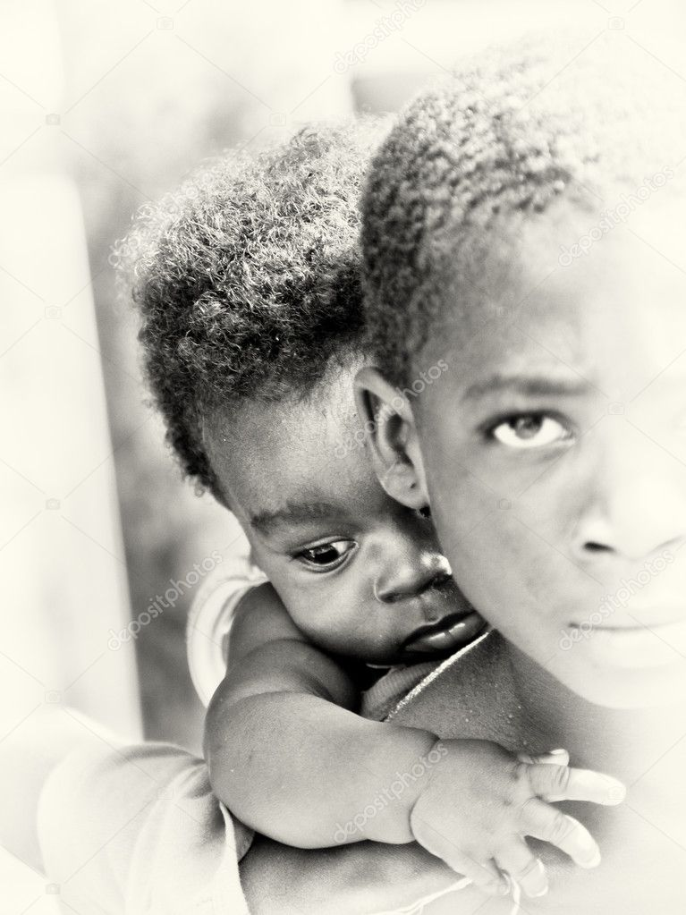 Little baby boy from Ghana on the shoulder of his brother