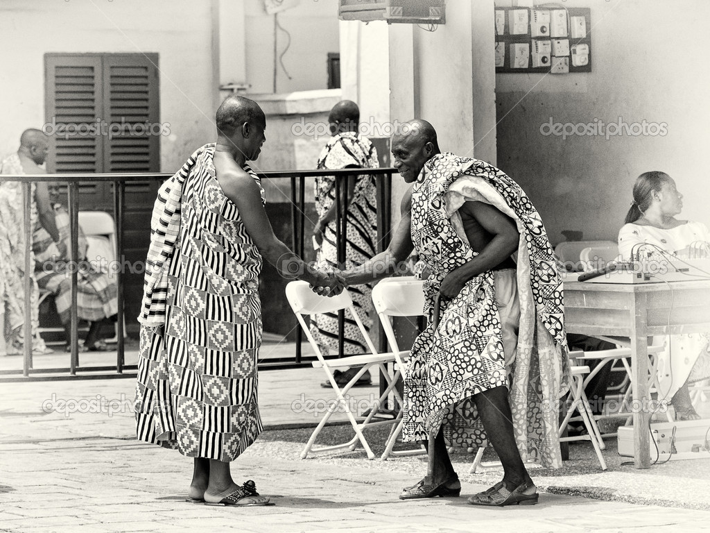 Two Ghanaian men shake hands each to other