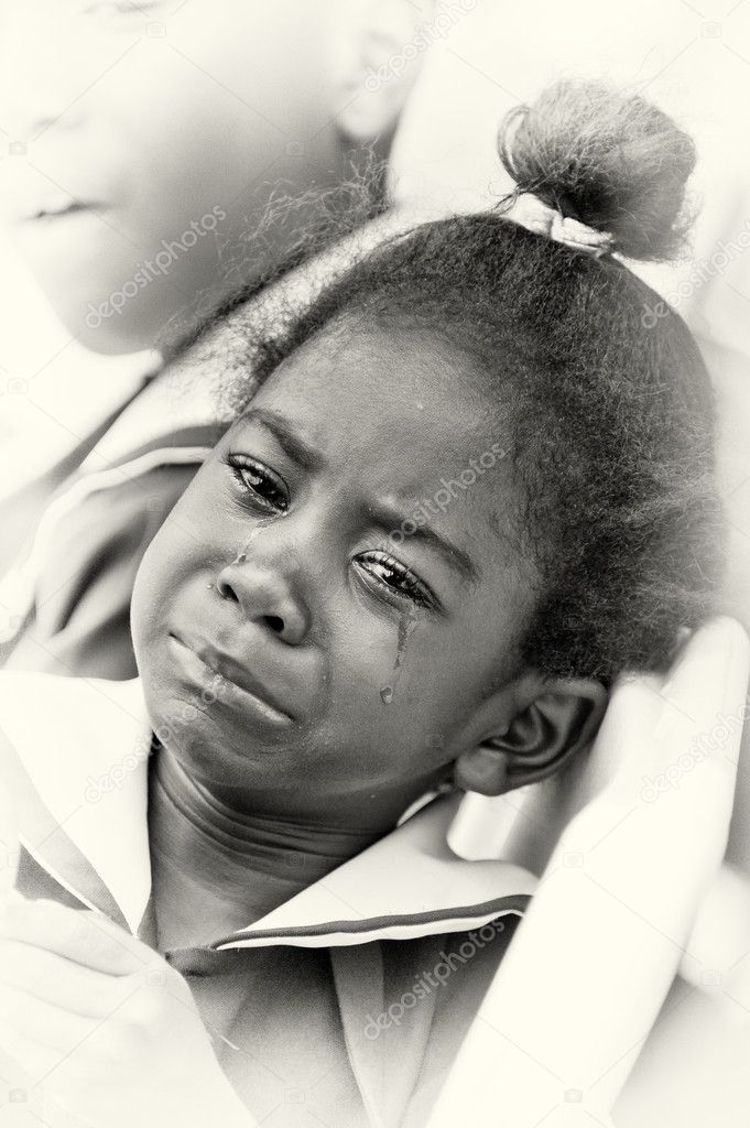 A portrait of a crying Ghanaian girl