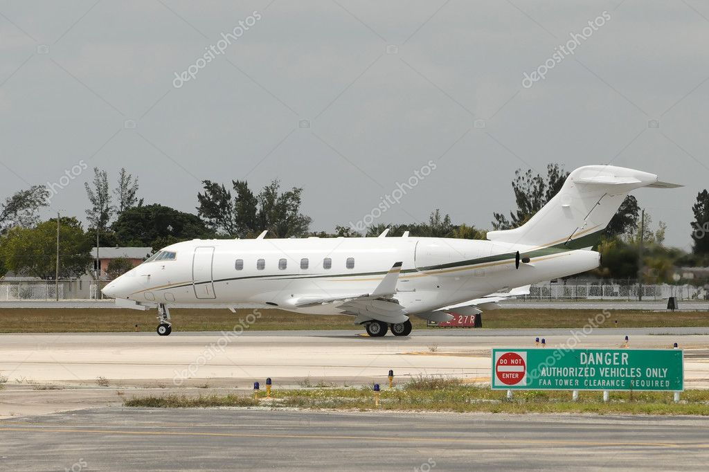 Private jet taxiing on the ground