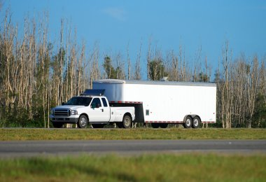 Truck towing trailer