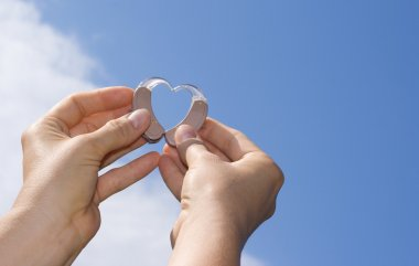 Showing a heart from hearing aids