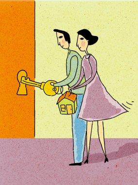 Couple holding house key to unlock door