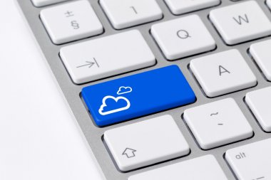 Keyboard with blue button showing cloud computing icon