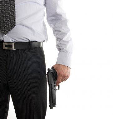 Man in suit with gun in his hand