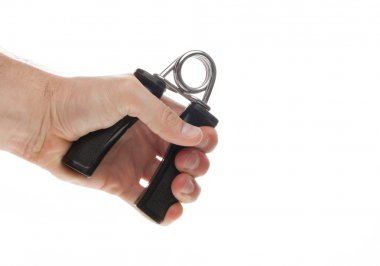 Exercising with a hand gripper.