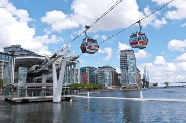 Visitors try out London's first cable car across the river Thames.