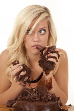 Woman handful of cake caught